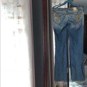 Very old Versace jeans with fold appliqué